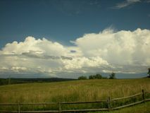 Clouds over the foothills. Wonderful cloudy and clear sky over the fields and foothills near Perryopolis PA Stock Image
