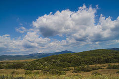 Clouds over the forest. Cumulus clouds over the forest stock photo