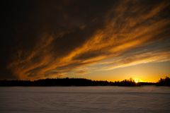 Clouds over baltic sea at sunset. Clouds over the frozen Baltic Sea at sunset Stock Photos
