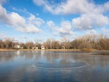 Clouds over a frozen lake. Frozen lake at early winter Stock Images