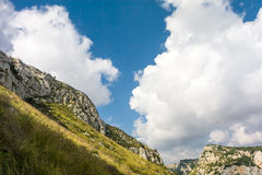 Clouds over grassy hillside Royalty Free Stock Photo