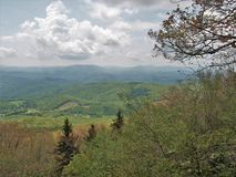 Clouds over Grayson Highlands State Park. Sun and clouds over Grayson Highlands State Park provides stunning views of the southwest Virginia Mountains Stock Photo