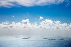Clouds over Great Barrier Reef stock images