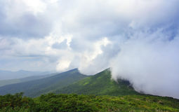 Clouds over the Great Smoky Mountains. Dense clouds rolling over the Great Smoky Mountains, part of the Appalachian Mountains Range royalty free stock image