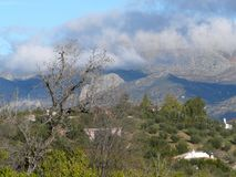 Clouds over green Hills. In Andalusia, Spain Stock Photos