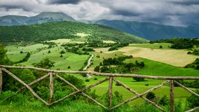 Clouds over green mountains in Italy stock footage