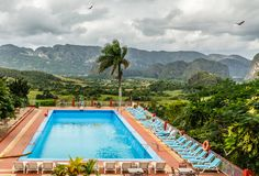 Clouds over green Vinales valley and blue swimming pool with dec royalty free stock photo