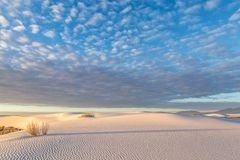 Sunrise at White Sands National Monument, New Mexico. Clouds over the gypsum sand at dawn, in White Sands National Monument, New Mexico royalty free stock photos