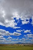 Clouds over a hill Royalty Free Stock Photo