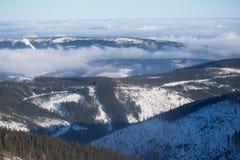 Clouds over the hills of Karkonosze. Krkonose Royalty Free Stock Photo