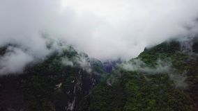 Clouds over Hills at Taroko Gorge National Park in Taiwan. Aerial view stock footage
