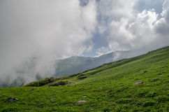 Clouds over Himalayas. A landscape consisting of clouds running over the Himalayan grasslands Stock Photo