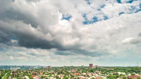 Time lapse. Cloudy clouds over the houses of the city of Rostov on Don