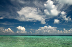 Clouds over Indian Ocean. White clouds over Indian Ocean seen from maldives stock photos