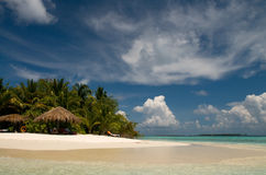 Clouds over Indian Ocean. White clouds and golden sand of Vilamendhoo island stock photos