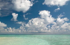Clouds over Indian Ocean. White clouds over indian ocean seen from Vilamendhoo island stock photography