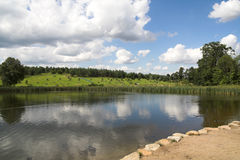 Clouds over lake. Gathering clouds reflected in a small lake Royalty Free Stock Images