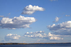 Clouds over a lake in Alberta, Canada Royalty Free Stock Images