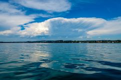 Clouds over Lake Constance. Cumulonimbus Clouds over the shore of the lake can be signs of an emerging Thunderstorm Royalty Free Stock Images