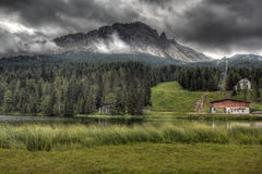 Clouds over lake Misurina, Dolomites, Italy. Misurina lake, Dolomites, Italy. The lake is famous for its beautiful views of the Tre Cime di Lavaredo Royalty Free Stock Image