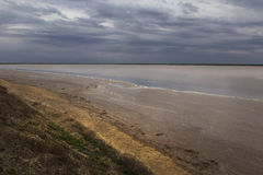 Clouds over the lake in the steppe Royalty Free Stock Image
