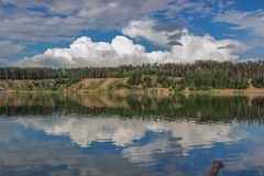 Clouds over the lake. In summer day Royalty Free Stock Photos