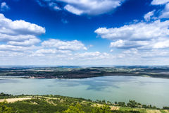 Clouds over the lake. Sunny day with some clouds above lake in Maravia royalty free stock photos