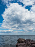 Clouds Over the Lake Superior Shore in Lutsen. This is the shore of Lake Superior in Lutsen, Minnesota. A massive cloud formation hovers over the lake Stock Photo