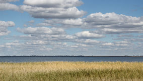 Clouds over the lake. View of the lake in the outback of Kazakhstan in cloudy weather Royalty Free Stock Photo