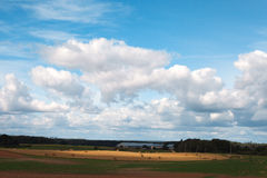 Clouds over land. Royalty Free Stock Image