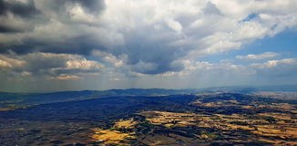 Clouds over the land. An aerial picture of Clouds over land in a greek town thessaloniki,in a day of september Stock Photo