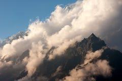 Clouds over the Langtang Lirung Peak. Evening clouds over the Langtang Lirung Peak from route to Kangja La, Langtang National Park, Langtang & Helambu, Nepal Stock Photo