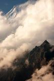 Clouds over the Langtang Lirung Peak. Evening clouds over the Langtang Lirung Peak from route to Kangja La, Langtang National Park, Langtang & Helambu, Nepal Stock Images