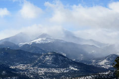 Clouds over Long's Peak at Rocky Mountain National Park. Clouds overtaking Longs Peak at Rocky Moyntain National Park stock images