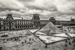 Clouds over Louvre. One cloudy day in Louvre, Paris royalty free stock image