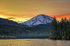 Clouds over Manzanita Lake and Lassen Peak at sunrise, Lassen Volcanic National Park Royalty Free Stock Images