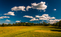 Clouds over a meadow in Antietam National Battlefield Stock Images