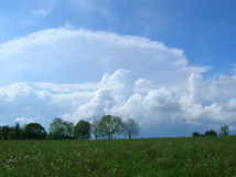 Clouds over the meadow Royalty Free Stock Images