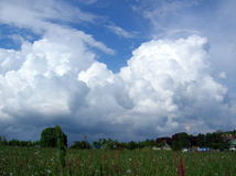 Clouds over the meadow Stock Photography