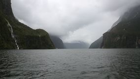 Clouds over Milford Sound stock video footage