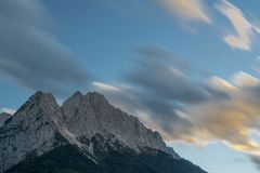 Clouds over mountain long time exposure stock images