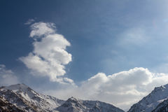 Clouds over mountain peaks Royalty Free Stock Photo