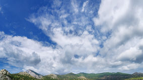 Clouds over mountain peaks Royalty Free Stock Image