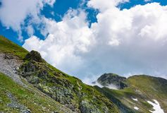 Clouds over the mountain ridge. With rocky cliffs. beautiful summer scenery of Fagaras mountains Royalty Free Stock Photos