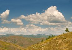 Clouds over the mountain scenery. East-Kazakhstan region of Kazakhstan, near the city of Serebryansk royalty free stock photo
