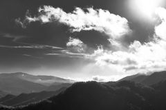 Clouds over mountains Royalty Free Stock Photography