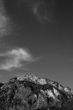 Clouds over mountains. Black and white scenic view of clouds over snow capped mountain peak Royalty Free Stock Image
