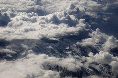 Clouds over mountains Royalty Free Stock Images