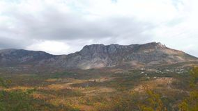 Clouds over the mountains in autumn, time lapse stock footage