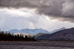 Clouds over the mountains and big lake. Royalty Free Stock Photography